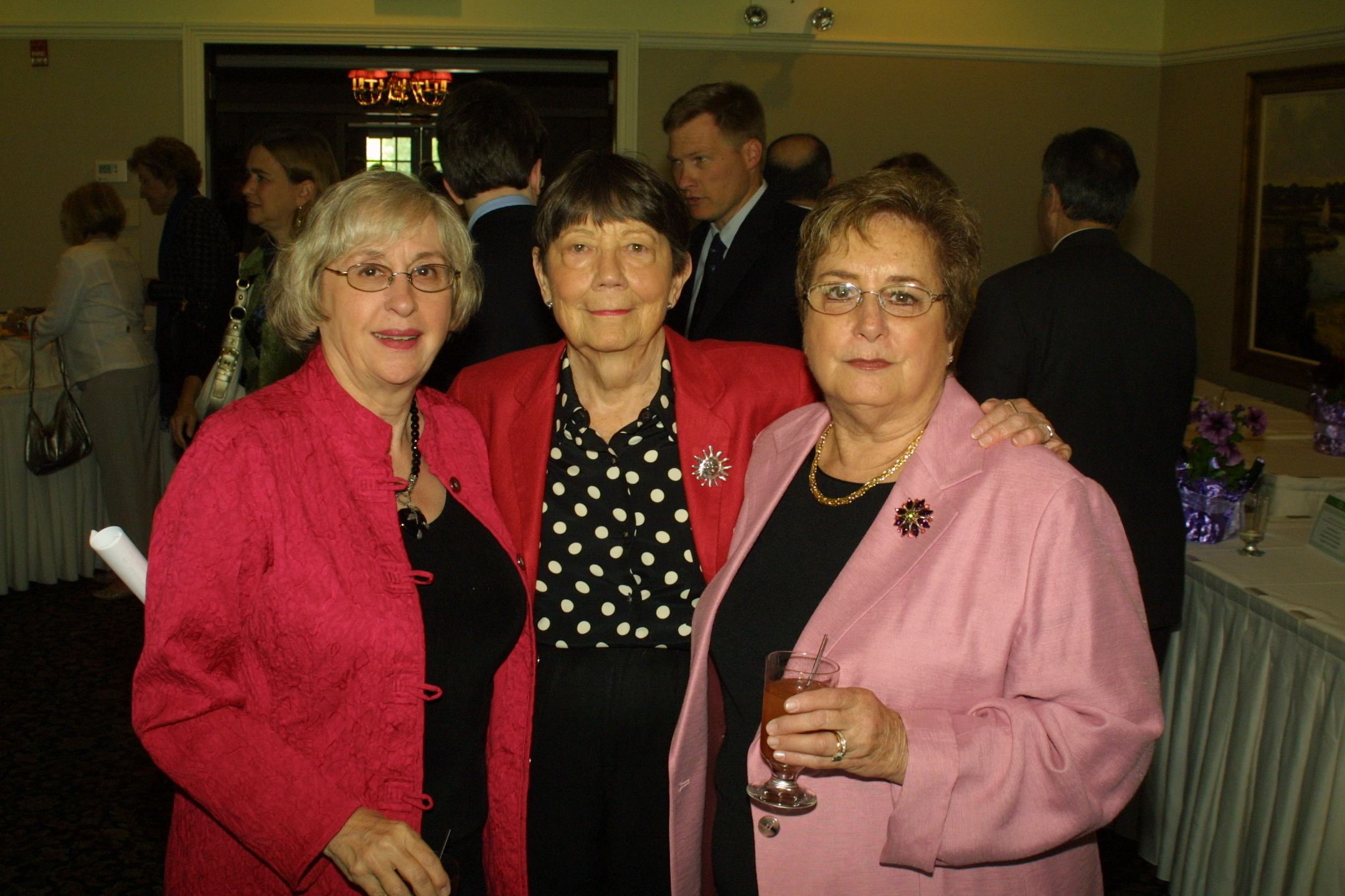 Julie Geller, president of the library Board of Trustees, with FOL vice president Nancy Wright and friend