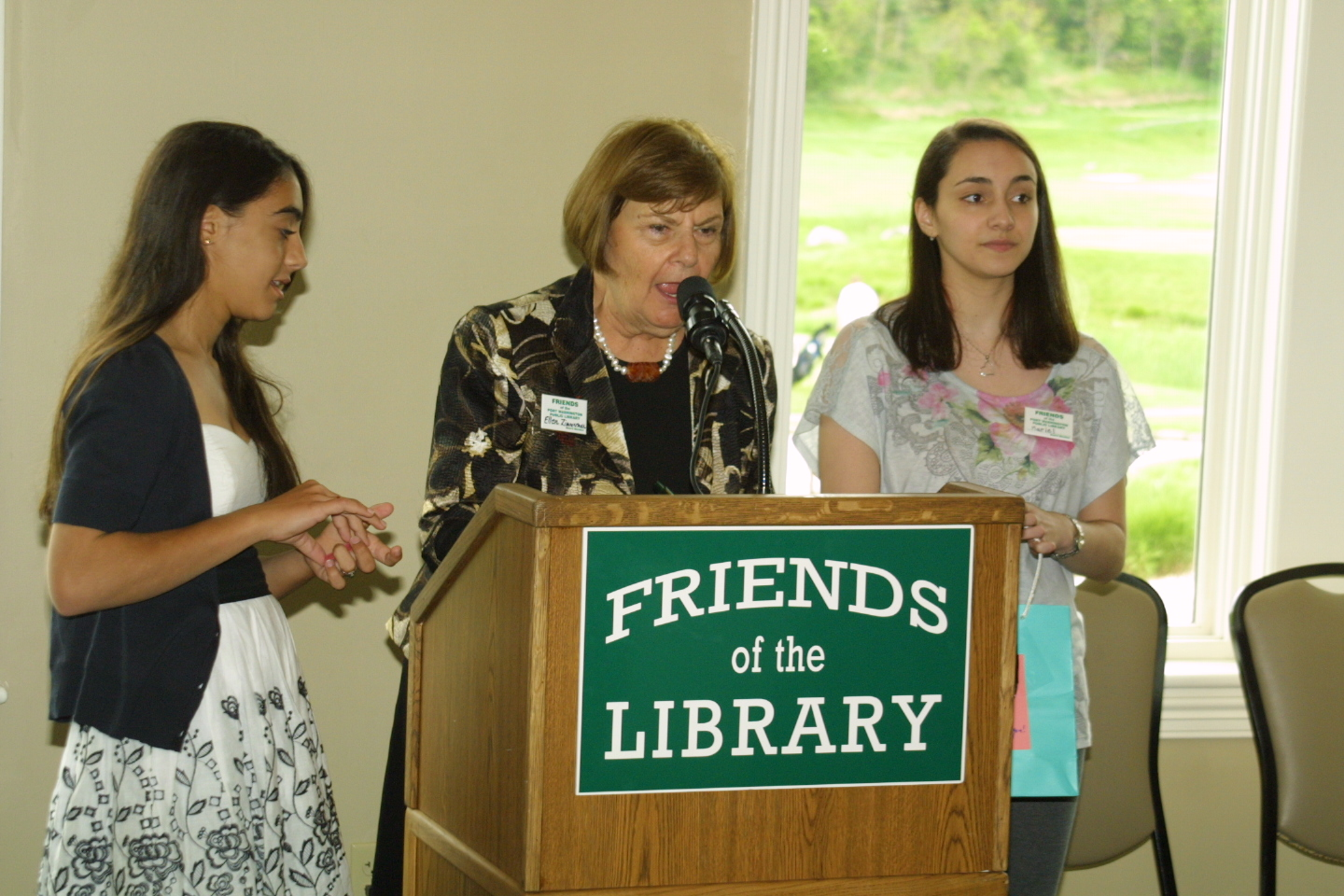 Ellen Zimmerman calls out raffle winners with assistance from teen volunteers Annelise Meyding and Mariel O'Connell