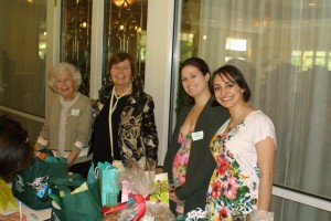FOL secretary Eleanor Rybecky, Vice President Ellen Zimmerman, and college volunteers Marissa Williams and Mariel O'Connell sold raffles for beautiful prize baskets